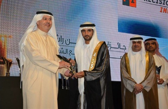 "H.H Sheikh Hamdan bin Mohammed bin Rashid Al Maktoum – Crown Prince of Dubai awarding PI with the Dubai SME Award for ""The Best Manufacturing Business 2013 in UAE"", PI MD, Mr. Motasim Al Daour receiving the prize"